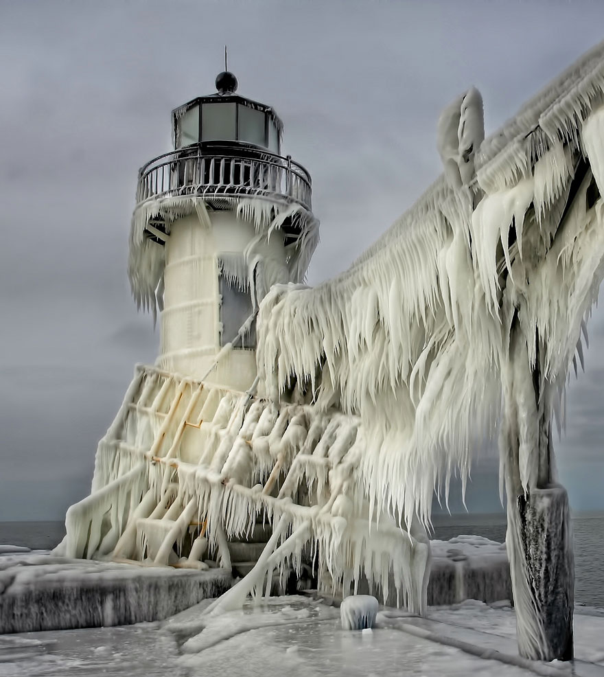 Frozen Lighthouse On Lake Michigan Shore